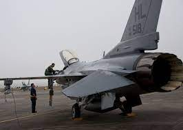 Tech. Sgt. Alan Hayford, crew chief in the 419th Aircraft Maintenance  Squadron, looks on as Maj. Shad Stromberg, 466th Fighter Squadron pilot,  climbs into h…   F 16