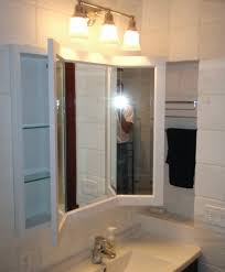traditional-bathroom-with-three-way-mirror-and-two-