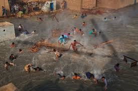 s big threat isn t terrorism it s climate change  dadu 13 flood victims scramble for food rations as they battle