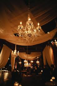 candle lit chandelier sheer ds and chandelier candlelight reception decor designs the wedding blog chandeliers on