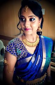 traditional south indian bride wearing bridal saree and jewellery reception look makeup by s