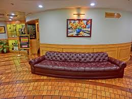 interesting saltillo tile with comfortable brown leather sofa for enchanting interior home design