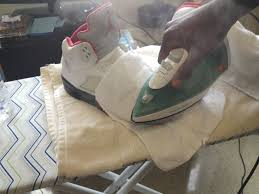 how to get creases out of leather shoes with iron
