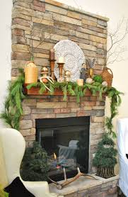 decorations rustic stone fireplace with nature themed fireplace decor feature fresh pine leaves mantel garland and wicker vases with twigs