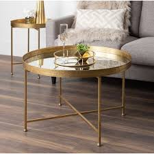 Choosing the best coffee table may pose a challenge with all the different options available out there for all types of tables. Kate And Laurel Celia Metal Glass Round Mirrored Coffee Table Overstock 27341034
