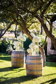 country themed wine barrel decoration ideas with flowers