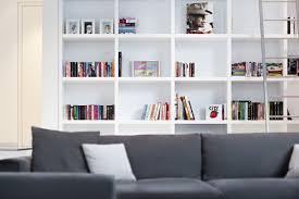 white finish library bookshelf toward modern ottoman chair on