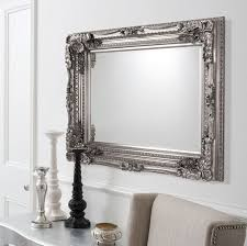 carved ornate framed silver wall mirror
