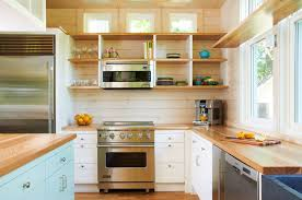 these wooden shelves are deep and divided but lack cupboard doors which makes the fun colored plateugs act as kitchen decor