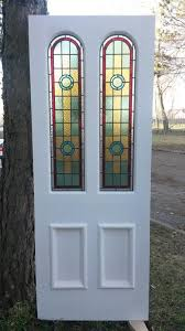 arched 4 panel front door with traditional stained glass