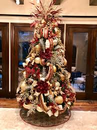 elegant burgundy champagne and gold christmas tree designed by