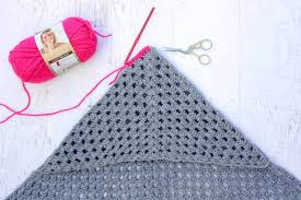 based on a large granny square the granny gives back crochet hooded blanket