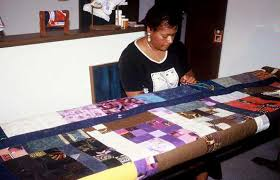 Quilting Links U.S. and Africa :: IRAAA & African American quilter works independently on patchwork quilt. Albertha  Martin - Kansas City, Kansas. Photo: Pearlie M. Johnson Adamdwight.com