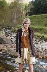 model in brown aviator jacket and gold skirt