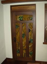 left craftsman single panel interior door in quarter sawn white oak with ebony inlay and custom craftsman trim right designer series custom california