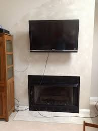 mount tv above fireplace hide wires