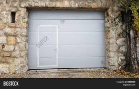 garage door inside. Modern Roll Up Metal Garage Doors With Integrated Smaller Inside Traditional Stone Wall Frame Door