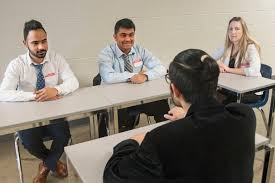 hr students host interview clinic n college three hr students interviewing another n student
