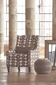 urban accents furniture. Urban And Industrial Accent Chair In A Room With Gray Pouf Next To The Accents Furniture