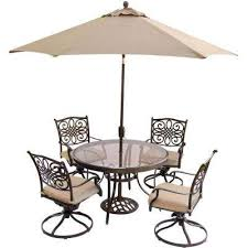 5 piece outdoor dining set with round glass table swivel chairs umbrella