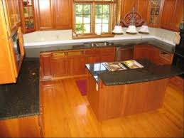 Image Of: Cork Floor With Oak Kitchen Cabinets