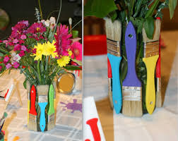 i cut paint splatters out of colorful card stock and set them in between the centerpieces