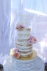 Naked Wedding Cake With Gold Leaf And Fresh Flowers Pretty Much