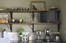 enticing wooden kitchen wall shelves with black metal support