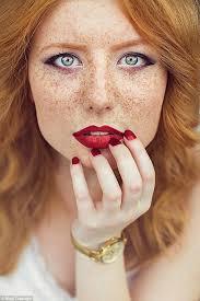Redhead lips spread wide