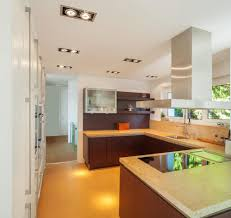marble flooring brightens kitchen bright toned kitchen is flush with yellow flooring beige marble counte