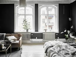 arched windows and black walls