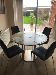 a round dining room table and four chairs