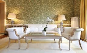 beautiful classic living room with lovely white sofa and armchairs also big veiled lamps and fascinating