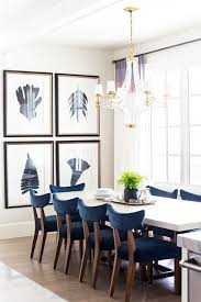 Blue Dining Room With Large Gallery Wall