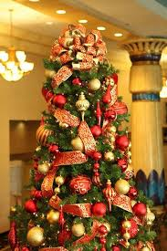 Red and Gold fabric bow Christmas tree topper for a at Commerce Casino