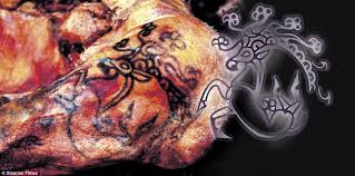 researchers have revealed the stunning tattoo of a russian princess which been preserved for hand holding mirror e11 mirror
