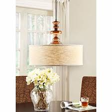 modern farmhouse chandelier for dining rooms kitchens and breakfast nooks drum light fixture is adjustable in height made of wood and fabric this