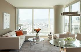 Example of a small trendy formal and open concept light wood floor living  room design in