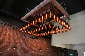 repurposed lighting fixtures. Bottles Transformed Into A Repurposed Light Fixture - 20 Unique Lighting Fixtures R