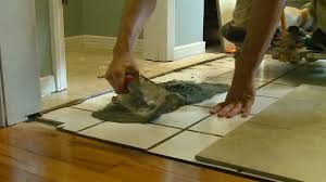 how to lay tile over a tile floor