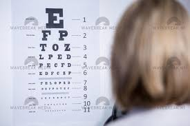 Optometrist Looking At Eye Chart License Download Or