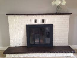 updated fireplace old white chalk paint on the brick and walnut wood stain on the mantel hearth stone chalk paint fireplace