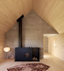 cabin inspired living room with wood panel walls nonagon style
