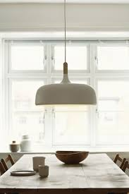 rustic kitchen island lighting. scandic style at its best the acorn pendant here over a rustic kitchen table island lighting