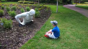 sir harold hiller gardens child looking at statue