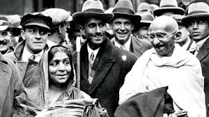 mahatma gandhi mahatma gandhi at boulogne station with sarojini naidu on the way to england to attend the round table conference