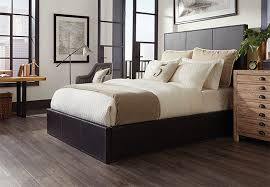 dark planks of wood look vinyl flooring in a master bedroom