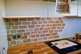 red brick backsplash kitchen
