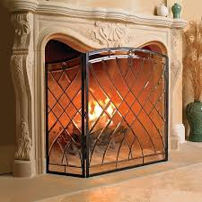 victoria glass fireplace screen allows visibility of the fire yet gives the appearance of