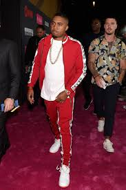 nas attends the mayweather vs mcgregor fight in a rolex watch graftz tracksuit and nike sneakers